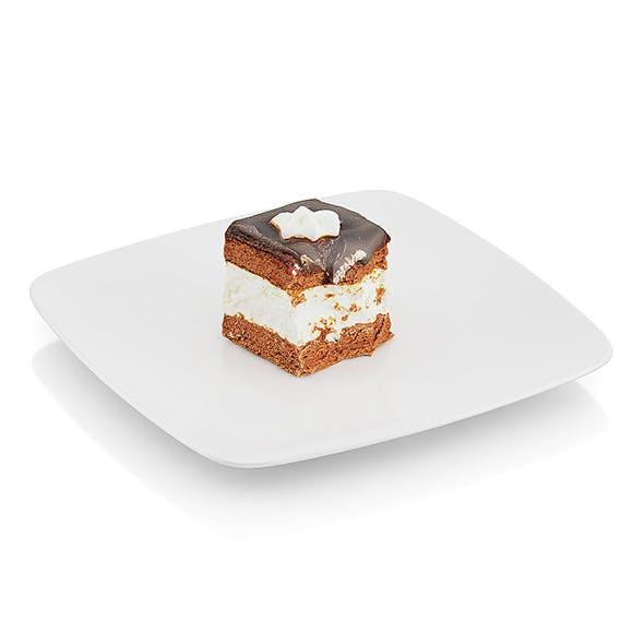 Half-eaten cream pie with chocolate icing