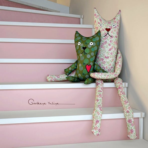 Textile toys cats hanging