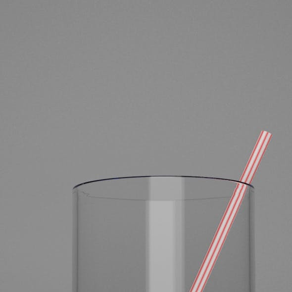 juice in a transparent glass with a stripped straw
