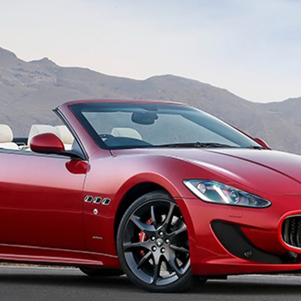 Red {convertible} Maserati GranTurismo MC.