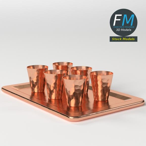 Copper shot glasses on a tray