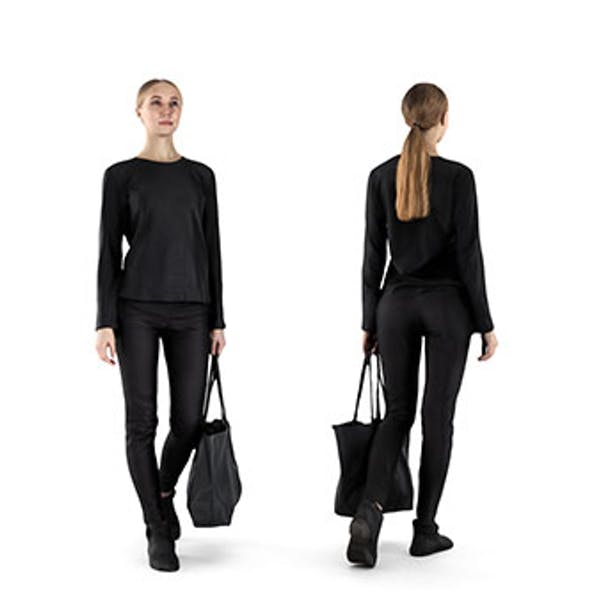 Young woman with bag walking 61