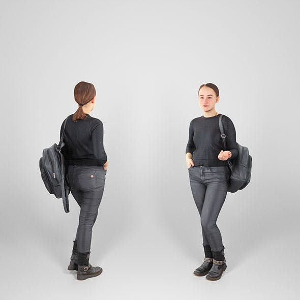 Woman dressed in black with backpack 100