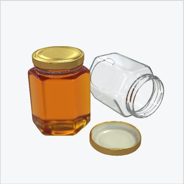 Honey in a glass hexagon jar