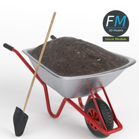 Wheelbarrow with soil and shovel