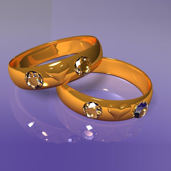 Golden rings with heart and brilliants.
